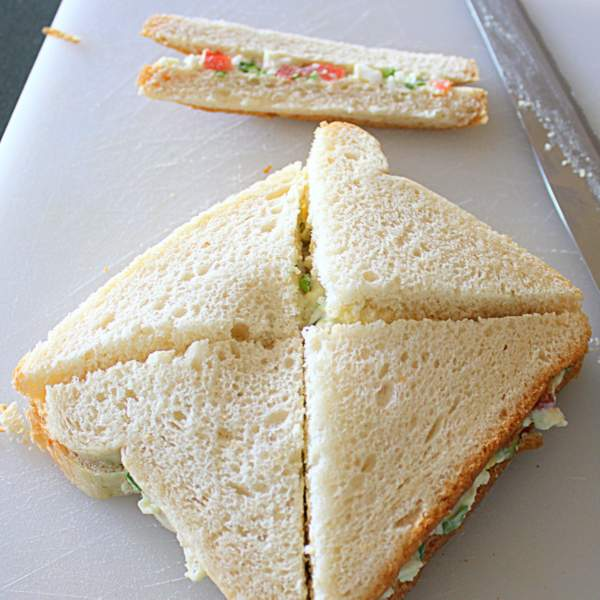 Cutting a sandwich into triangles.