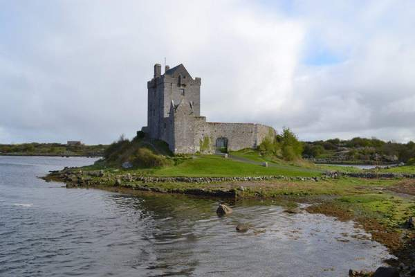 A castle surrounded by a body of water