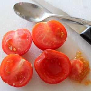 Roma tomatoes or other fleshy type tomatoes with seeds removed for salad sandwiches