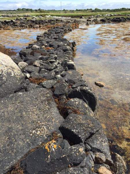 A rocky beach next to a body of water
