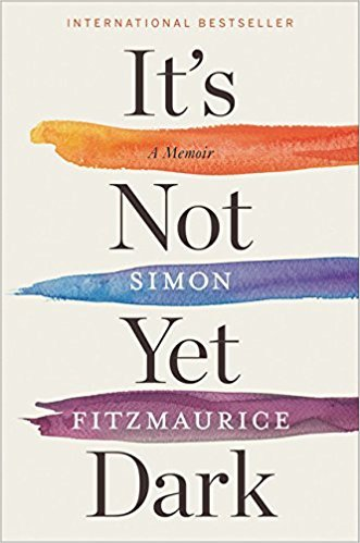 Text on a book cover with orange, blue and purple stripes