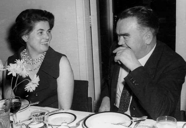 A man and a woman sitting at a table