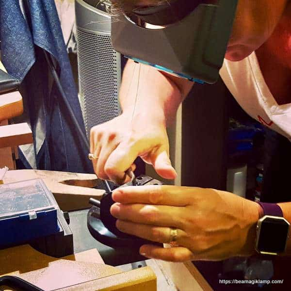 A jeweler\'s hands at work