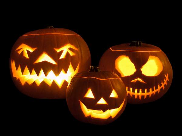 Pumpkins carved with scary faces and lit with tea lights