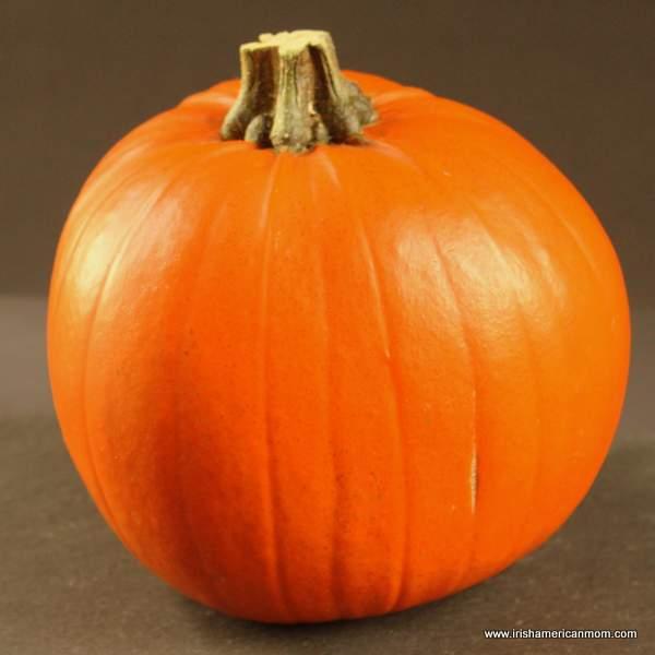 A medium uncut orange pumpkin