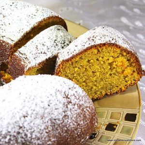 A bundt  cake covered in powdered sugar on a plate