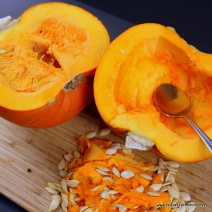Seed removal from a pumpkin with a metal spoon