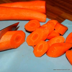 Carrots cut in chunks on a chopping board