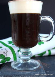 Irish coffee served in a glass with a handle to protect from burning
