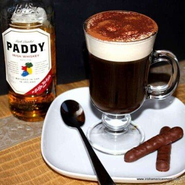 Irish coffee shown beside a bottle of Paddy Irish whiskey