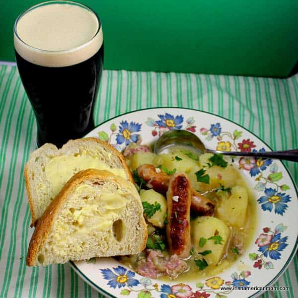 Dublin or Irish coddle ready for serving with bread and Guinness