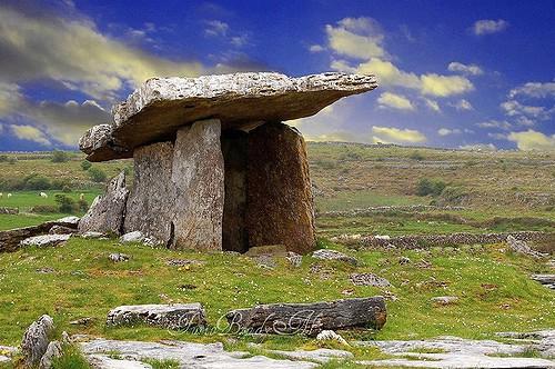A large flat topped dolmen in a rocky landscape