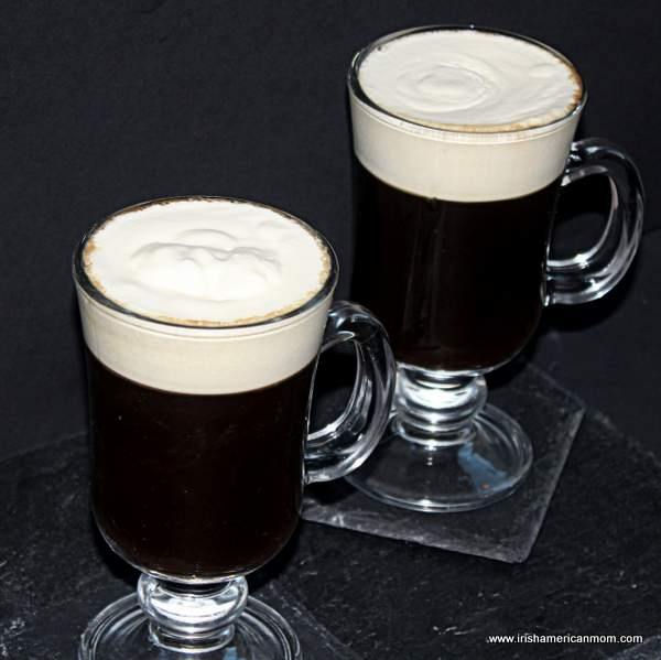Two glasses of Irish coffee with cream on top