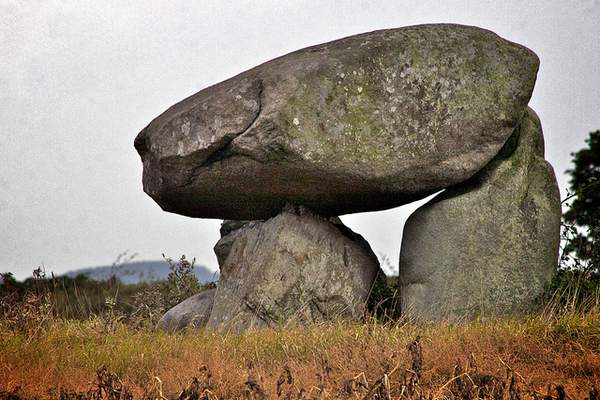 A large dolmen or megalith in a field