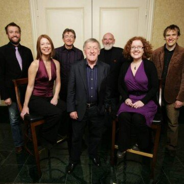 A group of musicians posing for a photo