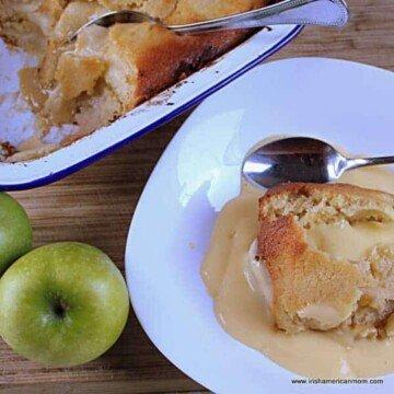 Custard over apple sponge pudding in a bowl