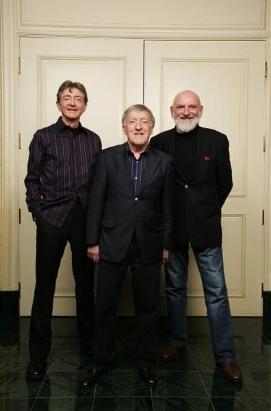 Three men posing for the camera