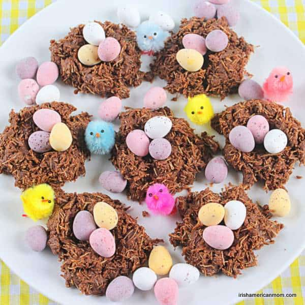 A white plate with seven chocolate nests with mini eggs