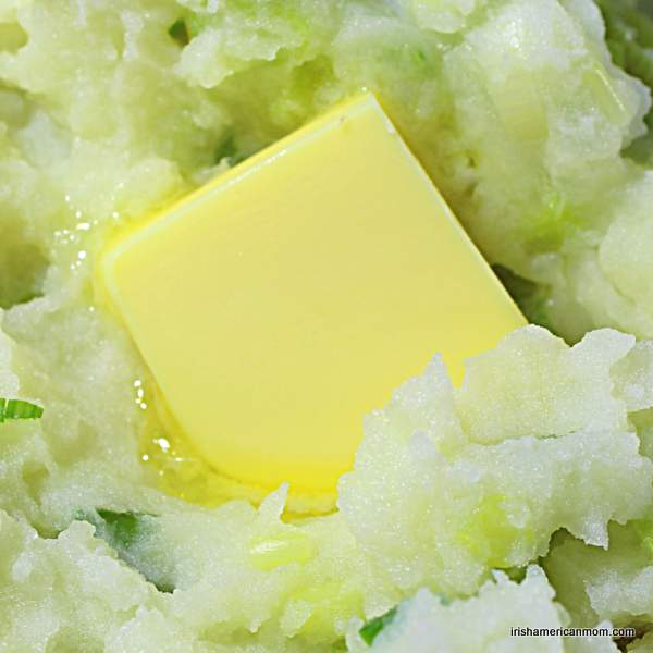 A knob of butter melting on champ or Irish mashed potatoes with green onions