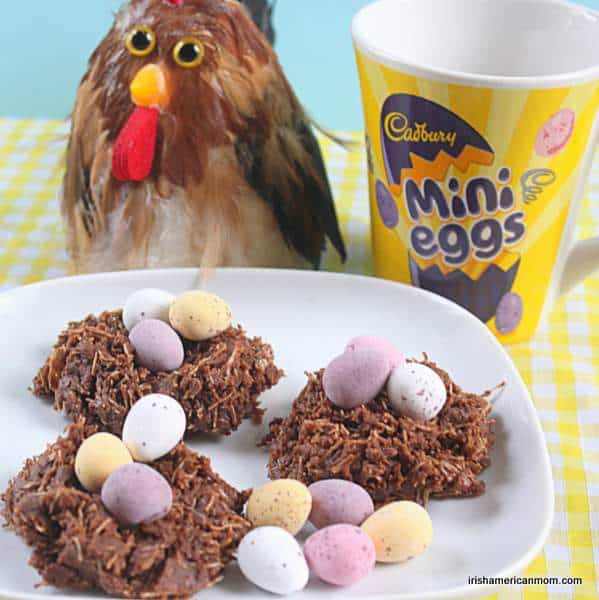 Easter nest treats for kids with a mini eggs mug and onlooking chicken