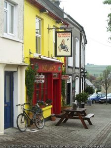 The front of an Irish Pub in County Cork painted yellow and red