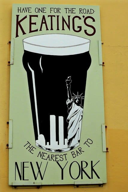 A close up of a sign showing a pint of stout