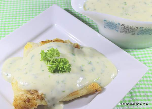 parsley sauce poured over pan fried cod