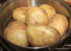 a pot of potatoes with their skins