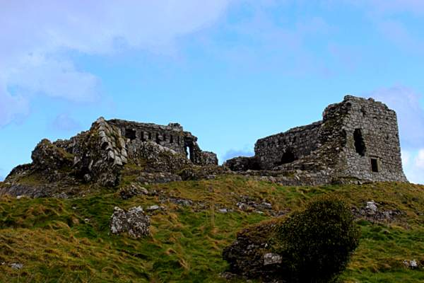 A ruined stone castle on a rocky hill
