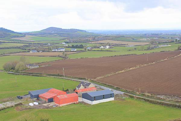 View from the Rock of Dunamase in County Laois showing farmland and the fertile fields of this midland part of Ireland.