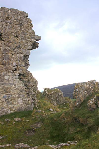 A broken stone castle wall