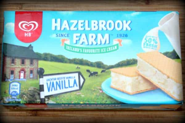 The front cover of a block of HB ice cream featuring a road sign saying vanilla and a stone Irish house