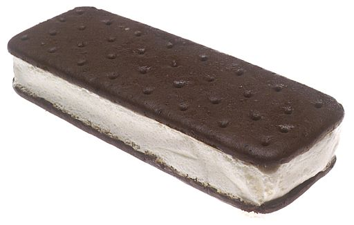 An American style ice cream sandwich with vanilla ice cream sandwiched between two chocolate cookies