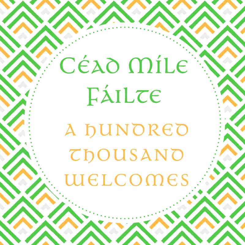 A green and orange graphic saying a hundred thousand welcomes in the Irish language