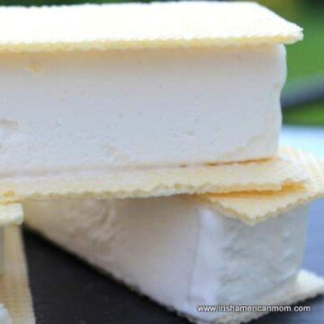 A slice of vanilla ice cream sandwiched between two wafers