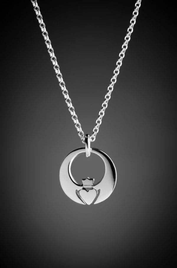 A necklace with a Claddagh pendant