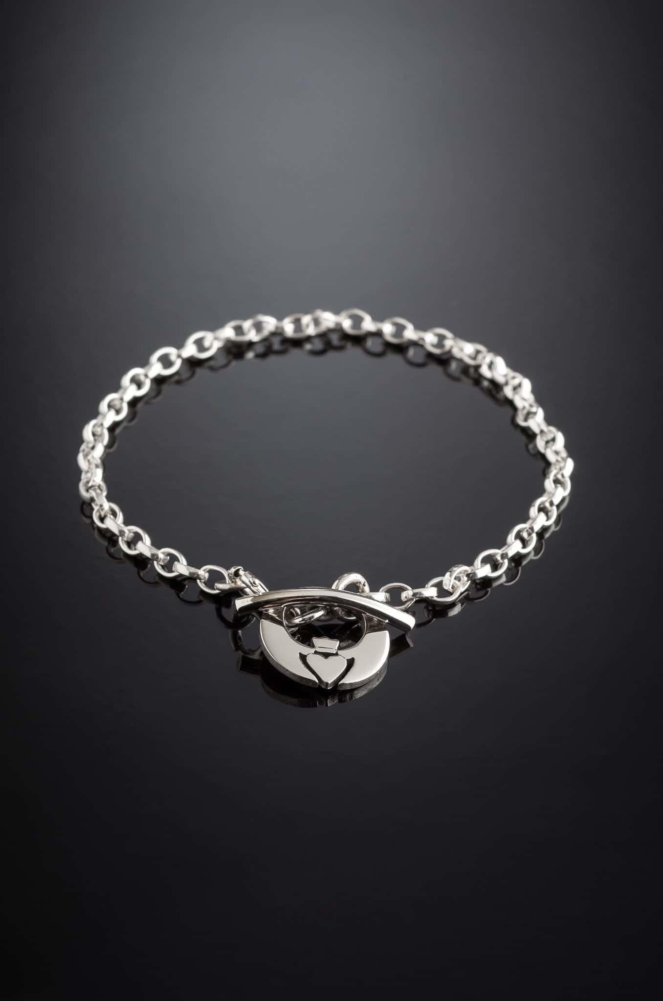 Irish Claddagh Sterling Silver Bracelet on a black background