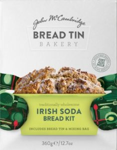 A loaf of Irish soda bread on a packet for a bread tin baking kit