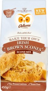 Packaging for brown scone baking mix featuring a buttered scone and owl logo