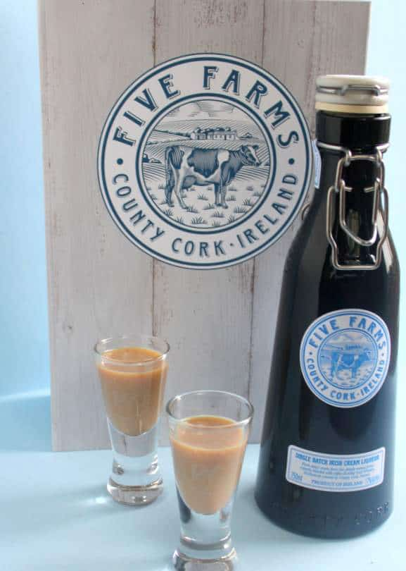 A bottle and a glass of Irish cream on a table