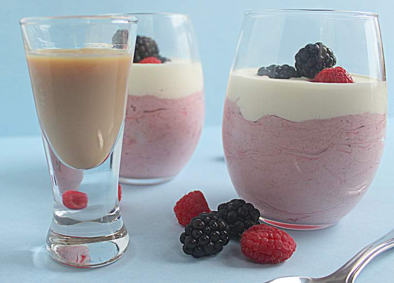 Berry creamy mousse desserts and a glass of Irish cream liqueur