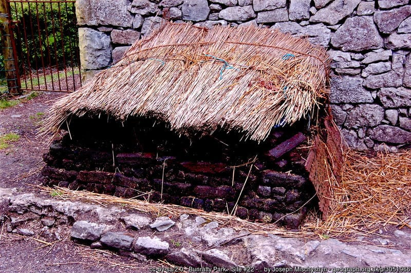 Sheafs of straw covering a stack of turf or peat