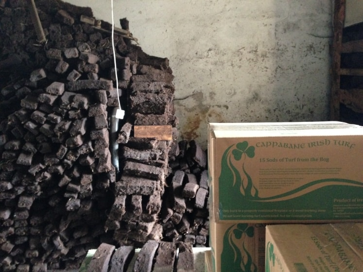 Peat or turf stacked in a store room