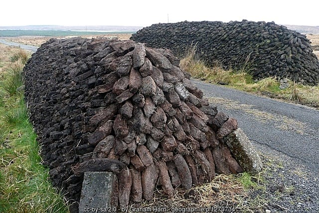 A close up of a stack of turf or peat