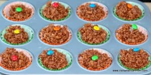Chocolate rice cereal cakes with candy decorations