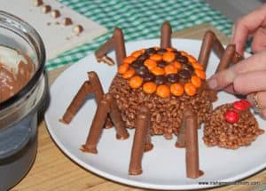 Instructions on how to add legs to a chocolate spider