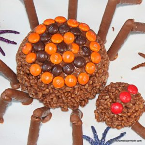 Decorated homemade chocolate spider for Halloween on a plate with spider decorations