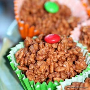 candy topped rice cereal cake in a paper baking case
