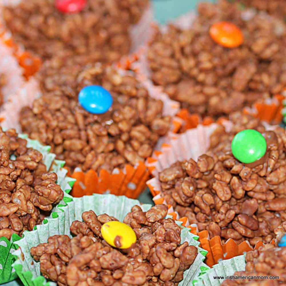 chocolate covered rice cereal buns with candy toppings