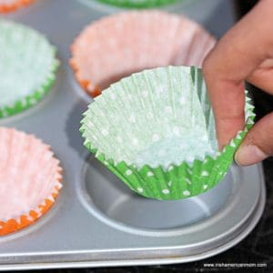 lining a muffin tray with paper cases